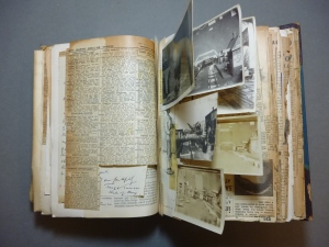 An example of one of the scrapbooks which contains both photographs and newsprint.