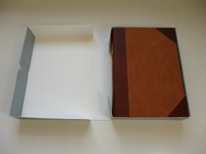 Scrapbook in clamshell box.